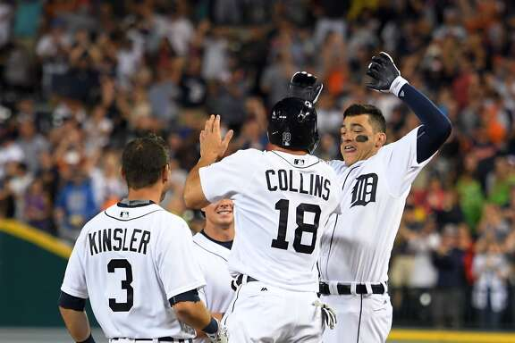 Detroit Tigers shortstop Jose Iglesias, right, celebrates with teammates Tyler Collins (18) and Ian Kinsler after hitting a walkoff RBI-single in the ninth inning of a baseball game against the Houston Astros, Saturday, July 30, 2016, in Detroit. (AP Photo/Lon Horwedel)