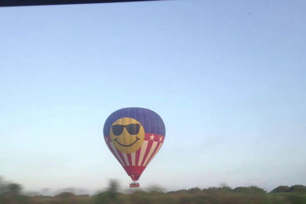 Tamara Calhoun captured this photo of the hot air balloon that crashed in Lockhart, Texas. All 16 passengers on board died when the hot air balloon hit power lines.