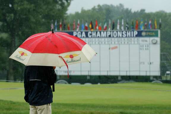 Umbrellas saw more action than golf clubs Saturday as only 37 players were able to complete their rounds.