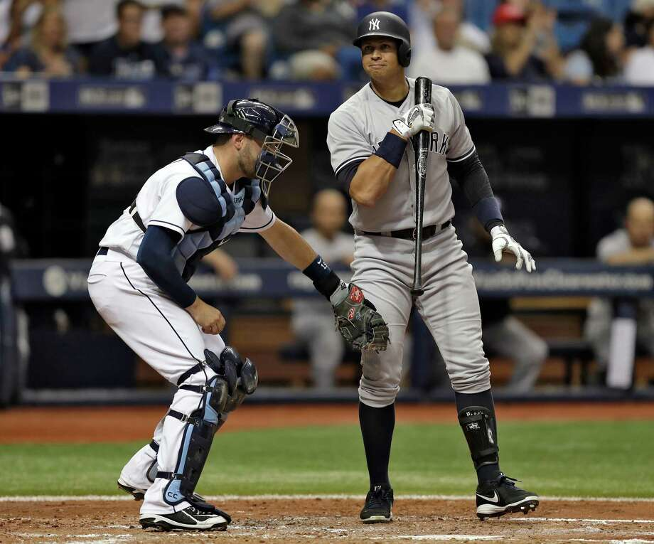 Tampa Bay Rays catcher Curt Casali (19) tags New York Yankees' Alex Rodriguez after Rodriguez struck out swinging against Drew Smyly during the fourth inning of a baseball game Saturday, July 30, 2016, in St. Petersburg, Fla. (AP Photo/Chris O'Meara) ORG XMIT: SPD109 Photo: Chris O'Meara / Copyright 2016 The Associated Press. All rights reserved. This m
