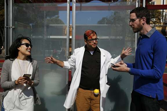 "San Francisco Examiner reporter Joe Fitzgerald Rodriguez, center, kicks off the PokŽmon Go ""duel"" between state Senate candidates Jane Kim, left, and Scott Wiener July 30, 2016 in San Francisco, Calif."