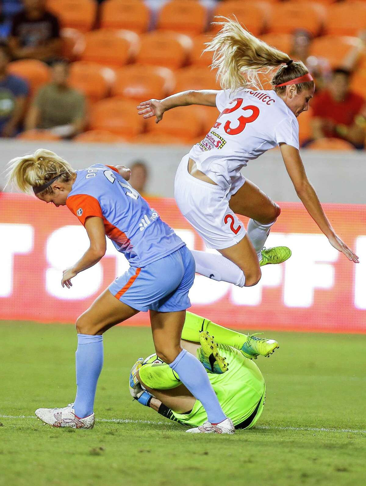 Western New York Flash defender Courtney Niemiec (23) jumps over her goalie, Katelyn Rowland, as she stops Houston Dash forward Rachel Daly (3) as the Houston Dash tie 3-3 with the Western New York Flash Saturday, July 30, 2016 in Houston.