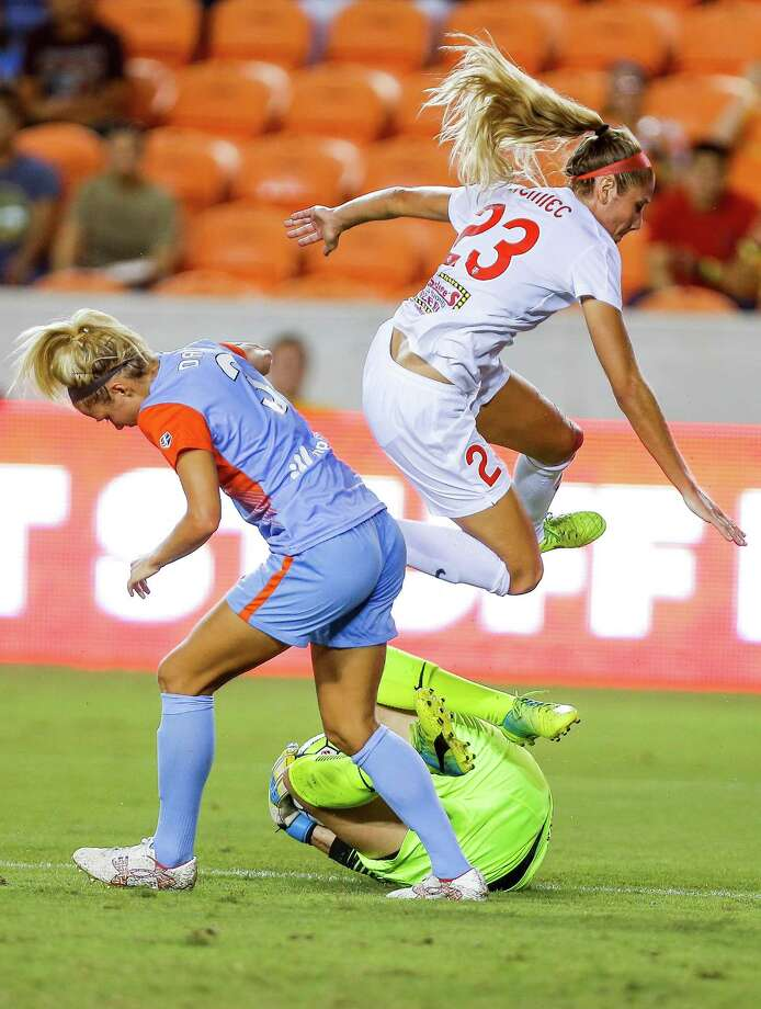 Western New York Flash defender Courtney Niemiec (23) jumps over her goalie, Katelyn Rowland, as she stops Houston Dash forward Rachel Daly (3) as the Houston Dash tie 3-3 with the Western New York Flash Saturday, July 30, 2016 in Houston. Photo: Michael Ciaglo, Houston Chronicle / © 2016  Houston Chronicle