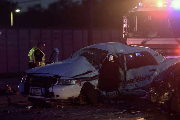 A Bexar County Sheriff's Office vehicle lays on Crestway and Kitty Hawk after it was involved in a crash with a speeding vehicle on Saturday, July 30, 2016. The deputy was transported via helicopter to hospital.