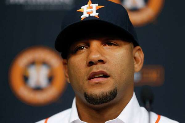 Cuban infielder Yulieski Gurriel speaks to the media after he signed a five-year, $47.5 million contract with the Houston Astros baseball team, Saturday, July 16, 2016, in Houston. (Karen Warren/Houston Chronicle via AP)