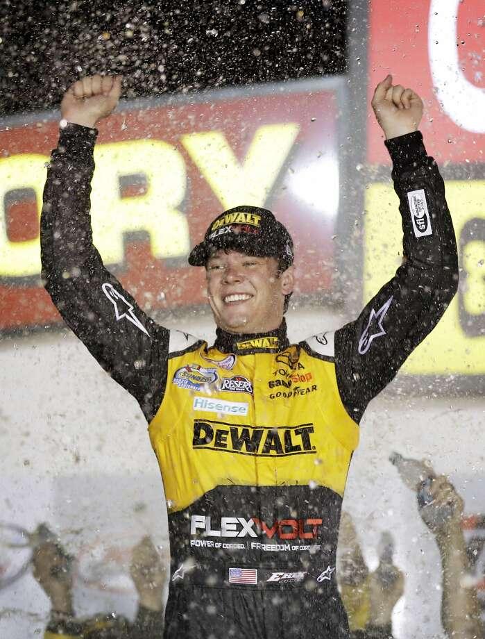 NASCAR rookie Erik Jones celebrates his win. Photo: Charlie Neibergall, Associated Press