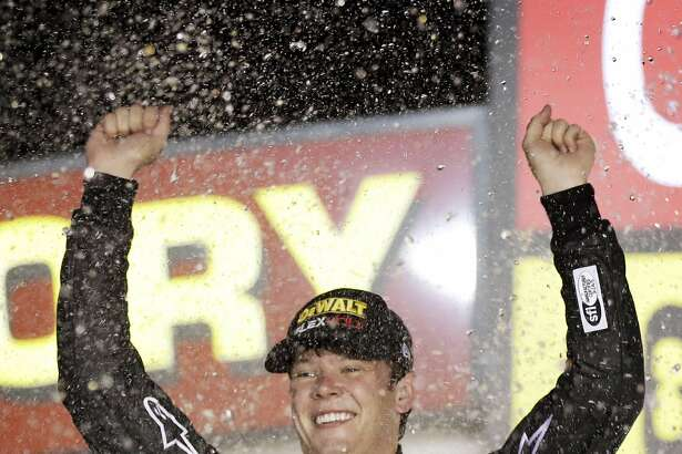 Erik Jones celebrates in Victory Lane after winning the NASCAR Xfinity Series auto race, Saturday, July 30, 2016, at Iowa Speedway in Newton, Iowa. (AP Photo/Charlie Neibergall)