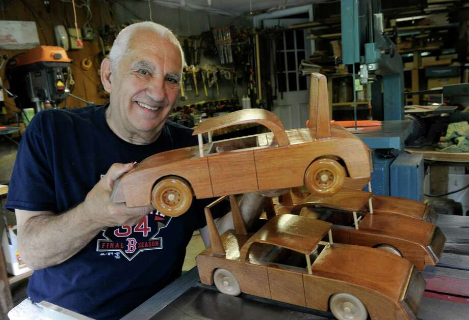 Roland Miller, 76, of New Milford, has created wooden toys —mostly vehicles — for many years and given them to local children. Photo: Carol Kaliff / Hearst Connecticut Media / The News-Times