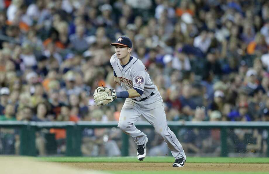 Houston Astros third baseman Alex Bregman rushes the roller hit by Detroit Tigers' Jose Iglesias during the seventh inning of a baseball game, Friday, July 29, 2016, in Detroit. (AP Photo/Carlos Osorio) Photo: Carlos Osorio, Associated Press / AP