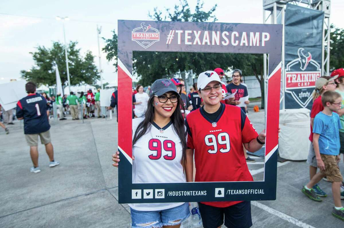 Houston Texans fans Brandy Martinez, left, and Janine Williams pose for a photo as they arrive for the first day of Texans training camp at Houston Methodist Training Center on Sunday, July 31, 2016, in Houston.