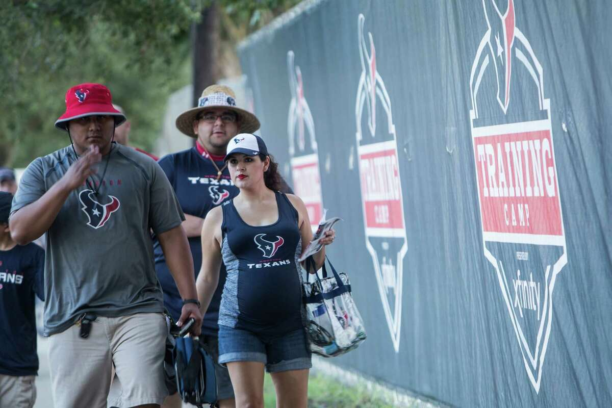 Houston Texans fans arrive for the first day of Texans training camp at Houston Methodist Training Center on Sunday, July 31, 2016, in Houston.