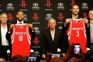 "Eric Gordon holds his jersey with ""10"" and Ryan Anderson holds his with a ""3"" as they take photos with coach Mike D'Antoni, owner Leslie Alexander, and GM Daryl Morey during a press conference at the Houston Rockets, Saturday, July 9, 2016, in Houston, as they introduced free-agent signees Ryan Anderson and Eric Gordon.    ( Karen Warren  / Houston Chronicle )"