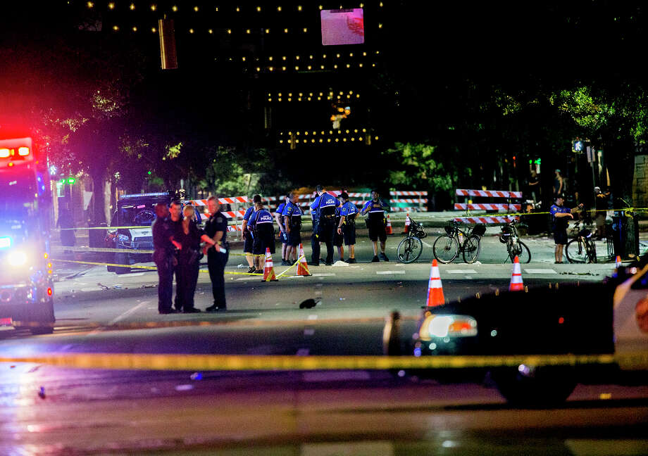 Police work the scene after gunshots rang out in downtown Austin, Texas, just as the bars were emptying early Sunday, July 31, 2016, leaving one woman dead and several others wounded, and police searching for a suspect.  (Ricardo B.Brazziell/Austin American-Statesman via AP) Photo: Ricardo B.Brazziell, AP / Austin American-Statesman