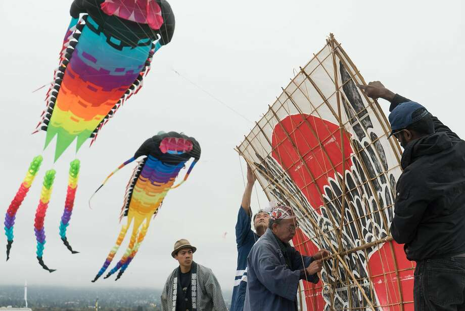 Left to right, Tako Age members, Ken Takeda, Yuji Goto, Kazuya Gojo and Sridhr Ramakrishnan build a traditional Japanese kite during the annual Kite Festival in Berkeley, Calif. on Sunday, July 31, 2016. The festival attracted scores of people with intricate kites. Photo: James Tensuan, Special To The Chronicle