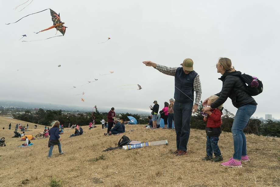 Jeremy and Anna Courval help their son Theodore fly a kite during the annual Kite Festival in Berkeley, Calif. on Sunday, July 31, 2016. The festival attracted scores of people with intricate kites. Photo: James Tensuan, Special To The Chronicle