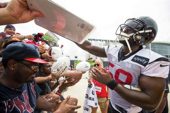 Houston Texans outside linebacker Whitney Mercilus (59) signs autographs during Texans training camp at Houston Methodist Training Center on Sunday, July 31, 2016, in Houston.