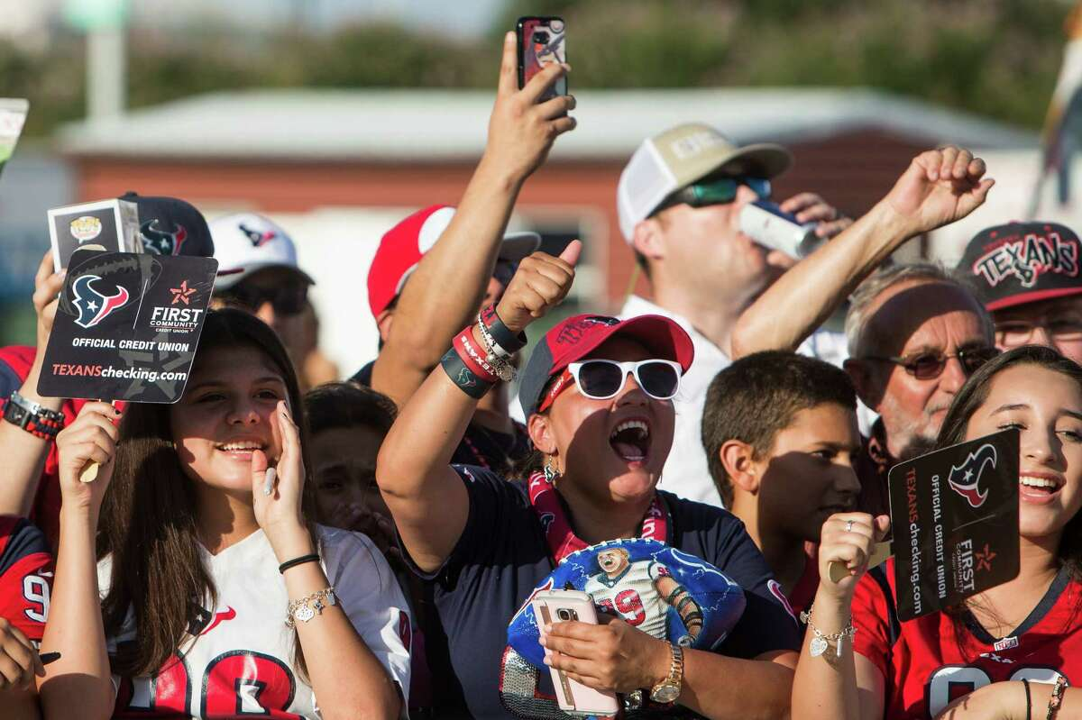 Houston Texans fans cheers as players make their way to the practice field for the first day of Texans training camp at Houston Methodist Training Center on Sunday, July 31, 2016, in Houston.
