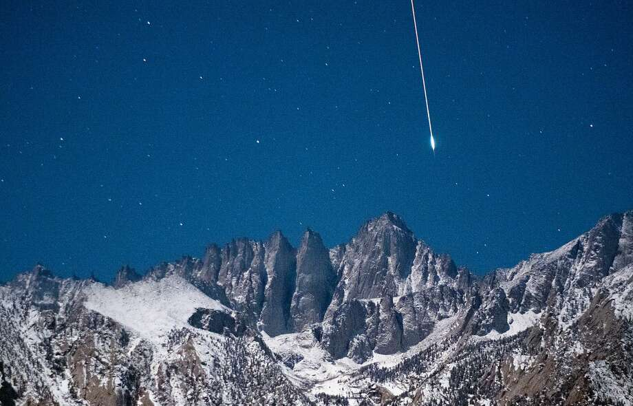 A Geminid meteor is captured in time-lapse photo over Mount Whitney in the Sierra Nevada east of Lone Pine Photo: Tony Rowell
