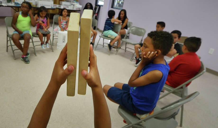 Blocks of wood are tapped together by campers during a music rondo for one of the classes at the Connecticut Yankee Council Summer STEM Camp at the South Norwalk Community Center on Thursday July 28, 2016 in Norwalk Conn. Photo: Alex Von Kleydorff / Hearst Connecticut Media / Connecticut Post