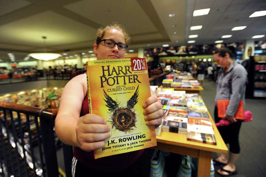 Virginia Clark, of Stamford, holds up her new copy of Harry Potter and the Cursed Child inside the Stamford Barnes & Noble on Sunday, July 31, 2016. Photo: Michael Cummo / Hearst Connecticut Media / Stamford Advocate