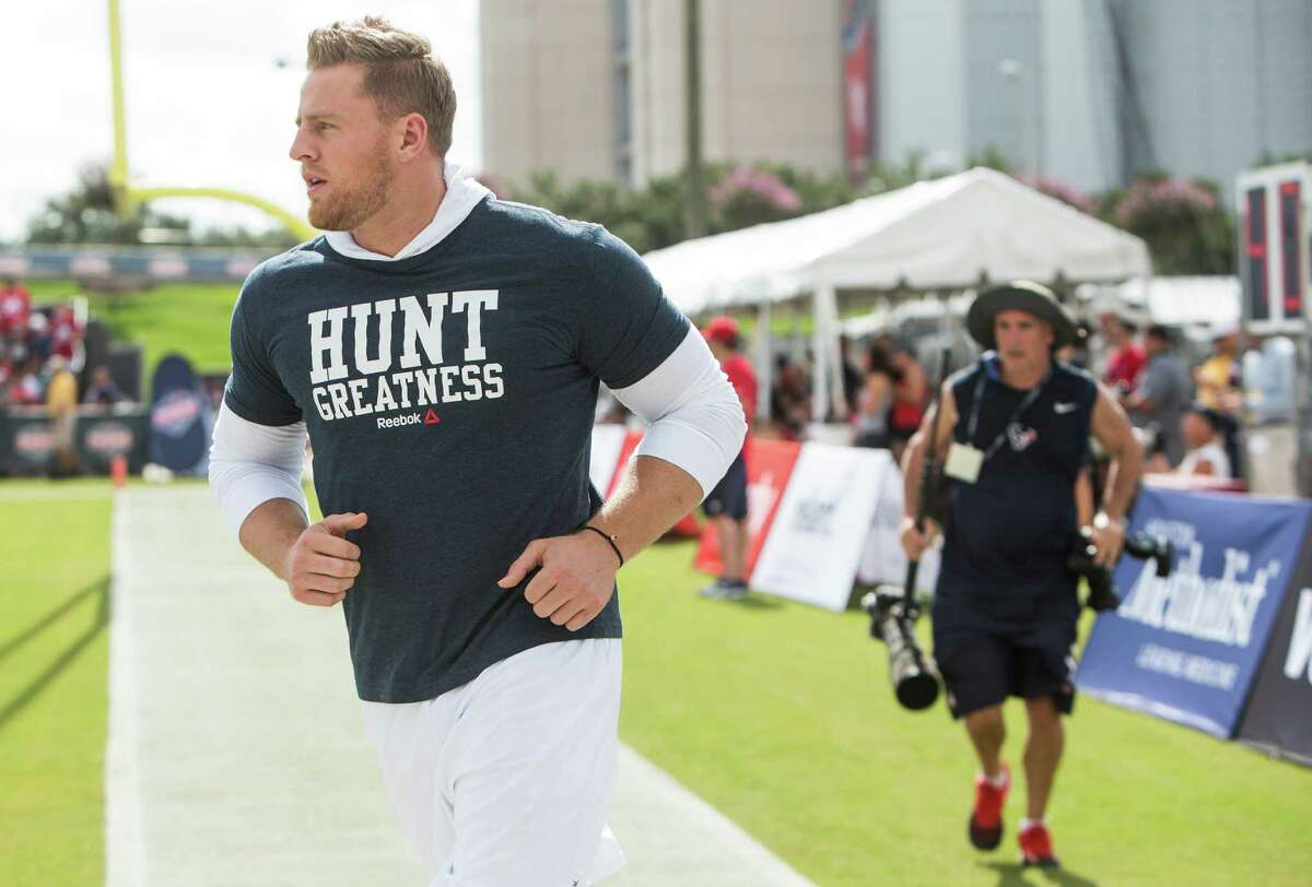 Houston Texans defensive end J.J. Watt runs onto the practice field during Texans training camp at Houston Methodist Training Center on Sunday, July 31, 2016, in Houston. Watt is unable to practice as he is recovering from back surgery.