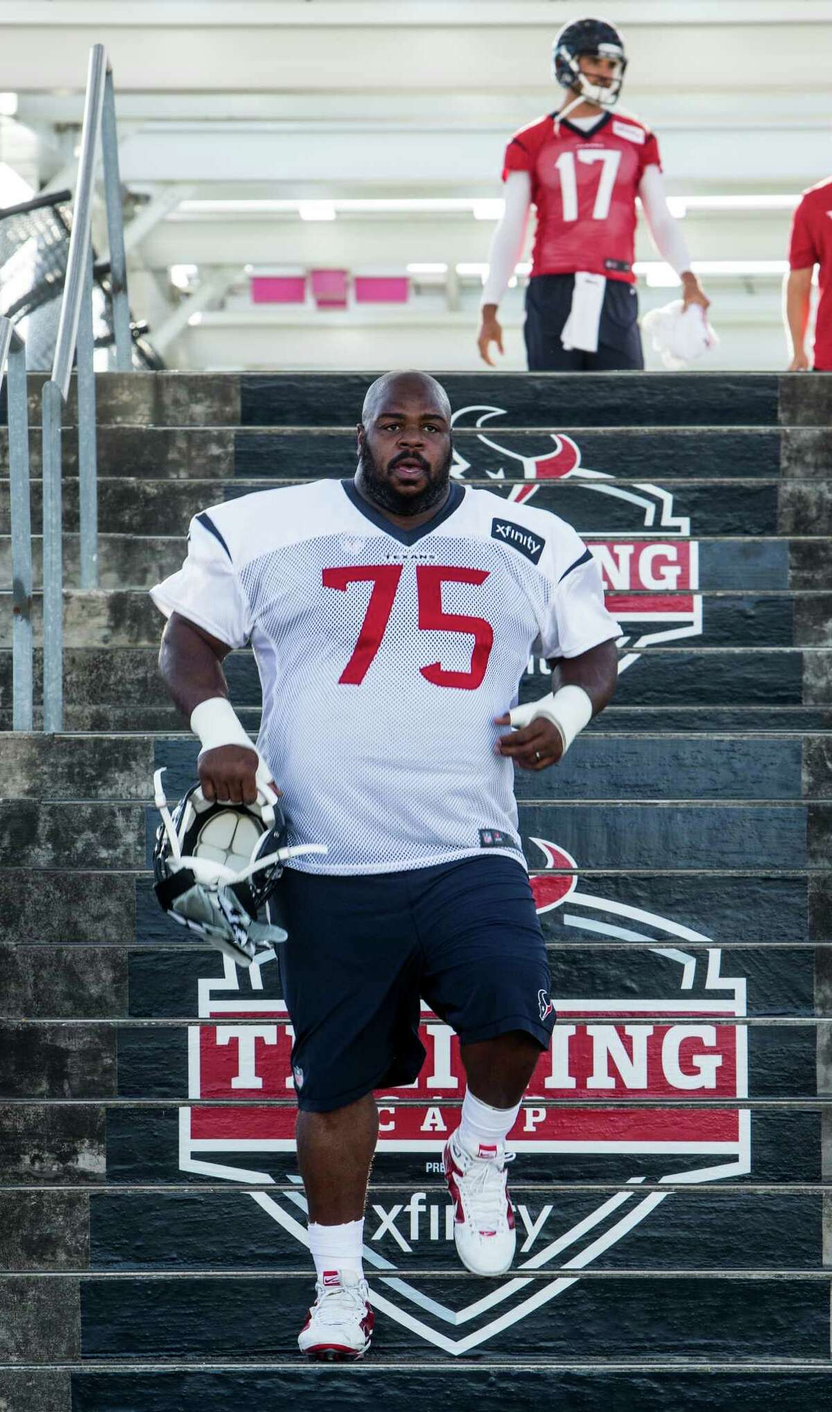 Houston Texans nose tackle Vince Wilfork (75) walks down the Kirby bridge stairway on his way to the practice field for the first day of Texans training camp at Houston Methodist Training Center on Sunday, July 31, 2016, in Houston.