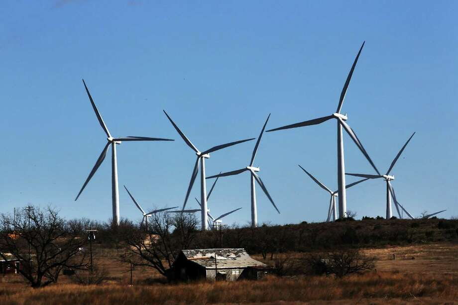 Wind turbines turn at a wind farm in Colorado City, Texas. There are perils in depending entirely on renewable energy sources. Photo: Getty Images File Photo / 2016 Getty Images