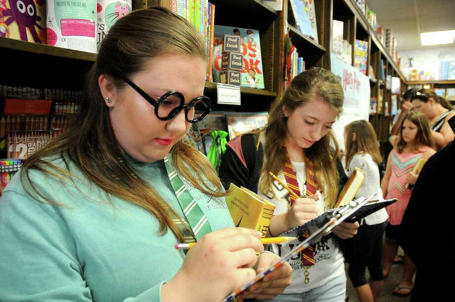 "Hannah Morris, left, and Valerie Lomonte complete ""Harry Potter""-themed puzzles at the release party for the script of ""Harry Potter and the Cursed Child"" at Blue Willow Bookshop on Sunday. The play premiered Saturday on London's West End. Photo: Dave Rossman, Freelance / Dave Rossman"