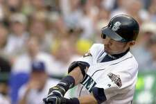 Seattle Mariners' Ichiro Suzuki connects on an infield hit to lead off for the American League in the first inning of the 72nd All-Star game on Tuesday, July 10, 2001, at Safeco Field in Seattle.