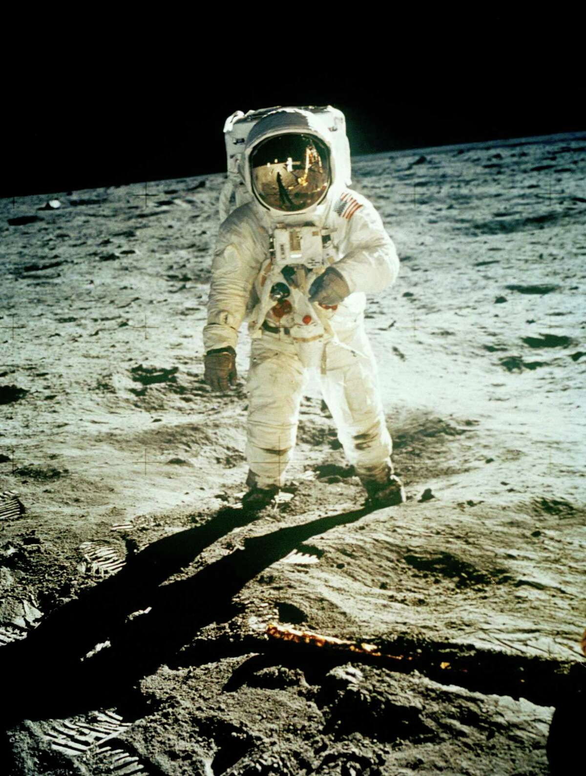 In this July 20, 1969 file photo from NASA, Astronaut Edwin E. Aldrin Jr., lunar module pilot, is photographed walking near the lunar module during the Apollo 11 extravehicular activity. (AP Photo, NASA ,file)