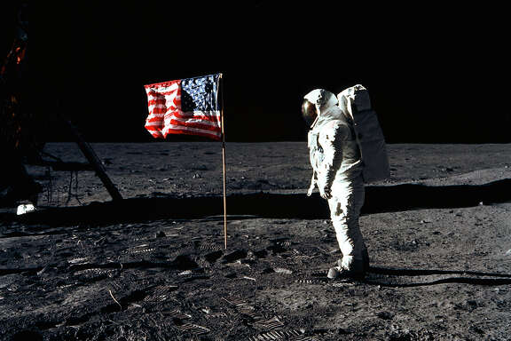 """Astronaut Edwin """"Buzz"""" Aldrin is shown on July 20, 1969, after landing at Tranquility Base. Astronaut Neil Armstrong took the photograph."""
