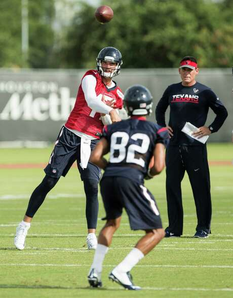 Under the watchful eye of Texans offensive assistant coach Pat O'Hara, quarterback Brock Osweiler throws to wide receiver Wendall Williams on Sunday, the first day of the team's training camp. Photo: Brett Coomer, Staff / © 2016 Houston Chronicle