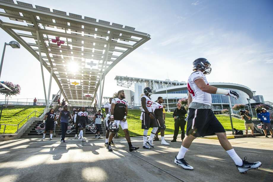 Houston Texans players make their way to the practice field for the first day of Texans training camp at Houston Methodist Training Center on Sunday, July 31, 2016, in Houston. ( Brett Coomer / Houston Chronicle ) Photo: Brett Coomer/Houston Chronicle
