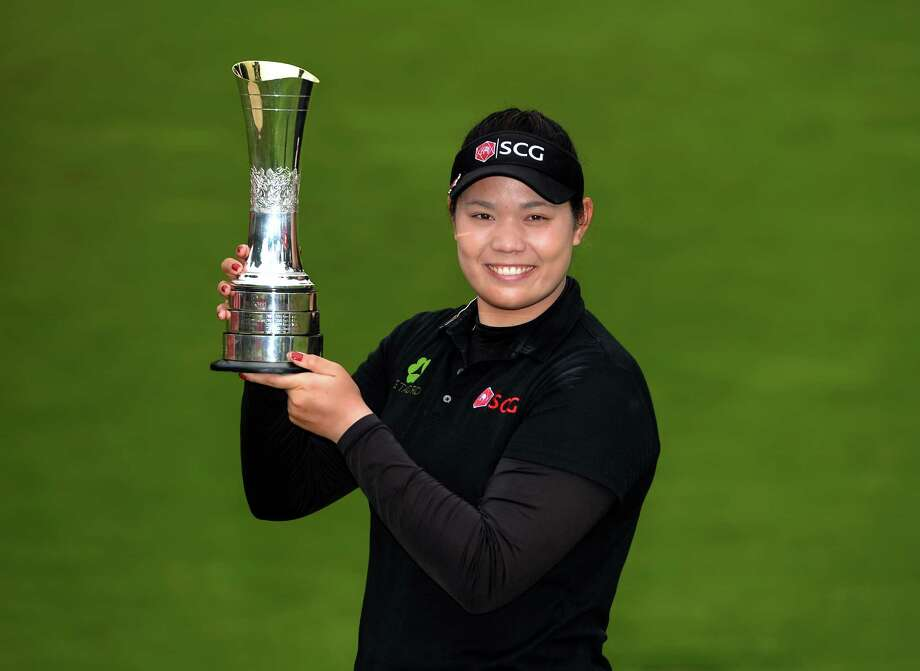 WOBURN, ENGLAND - JULY 31:  Ariya Jutanugarn of Thailand poses with the trophy after winning the Ricoh Women's British Open - Day Four at Woburn Golf Club on July 31, 2016 in Woburn, England.  (Photo by Tony Marshall/Getty Images) Photo: Tony Marshall, Stringer / 2016 Getty Images