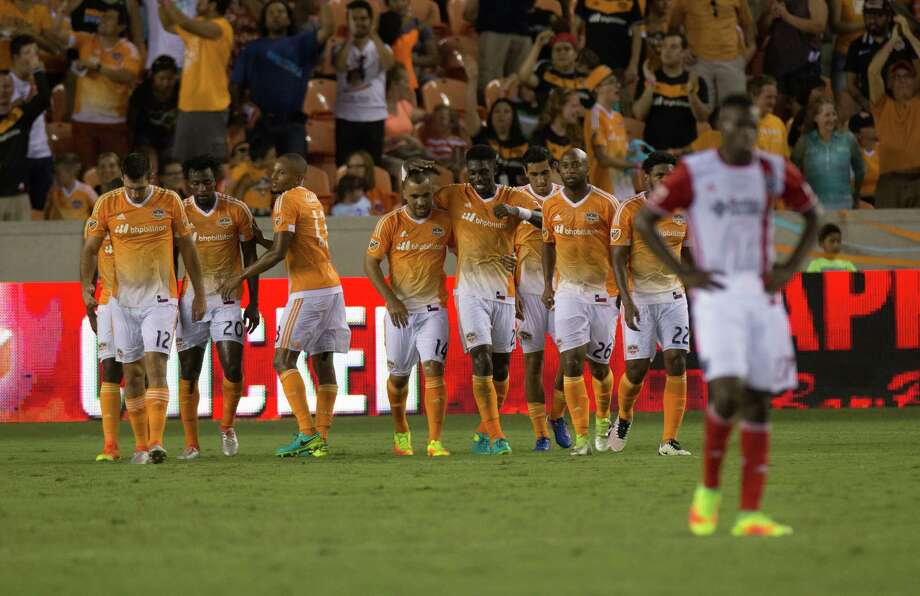 Houston Dynamo midfielder Alex (14) is hugged by Houston Dynamo defender Jalil Anibaba (2) after Alex scored during the first half of action between the between the Houston Dynamo and the San Jose Earthquakes during an MLS soccer game at BBVA Compass, Sunday, July 31, 2016, in Houston. (Juan DeLeon/for the Houston Chronicle) Photo: Juan DeLeon, FRE / Houston Chronicle