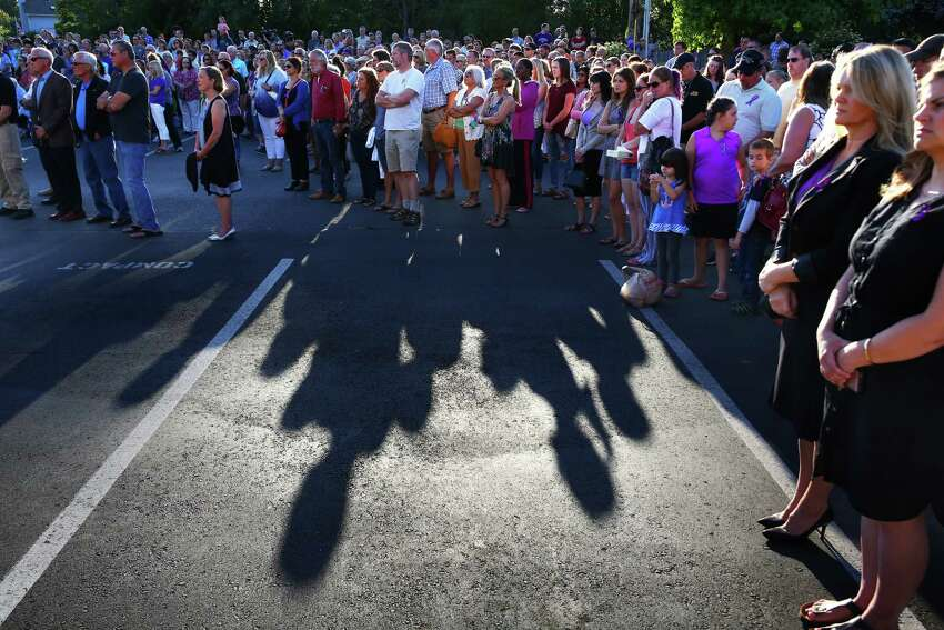 The community gathered for a vigil honoring the victims of a shooting that occurred early Saturday morning at a house in Mukilteo, killing three young people and injuring one, Sunday, July 31, 2016 at the Mukilteo Church of Jesus Christ of the Latter Day Saints.