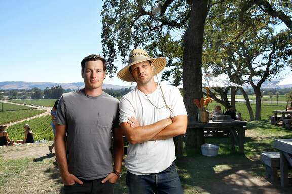 Andrew (right, wearing white t-shirt) and Adam (left, gray t-shirt) Mariani (they are brothers), co-owners of Scribe winery in Sonoma, California on Saturday July 30, 2016.