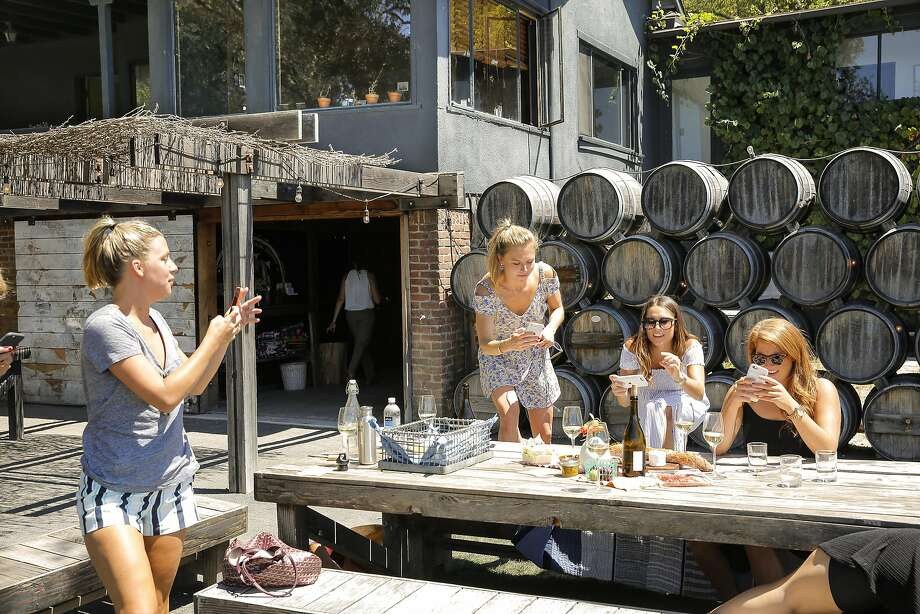 Left-right: Sally Poole (from SF), Emma Fox (SF), Nicolette Stains (NYC) and Lindsay Angelillo (NYC) taking photos of their food in the outdoor wine tasting area at Scribe. Photo: Craig Lee, Special To The Chronicle
