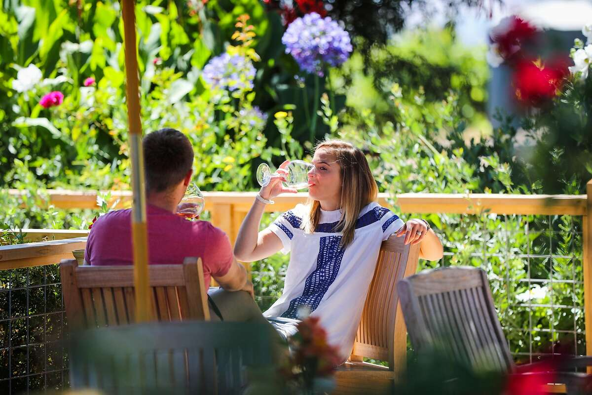 Tommy Buhr (left) and Emily Webb taste wine at Saintsbury winery, in Napa, California, on Monday, July 18, 2016.