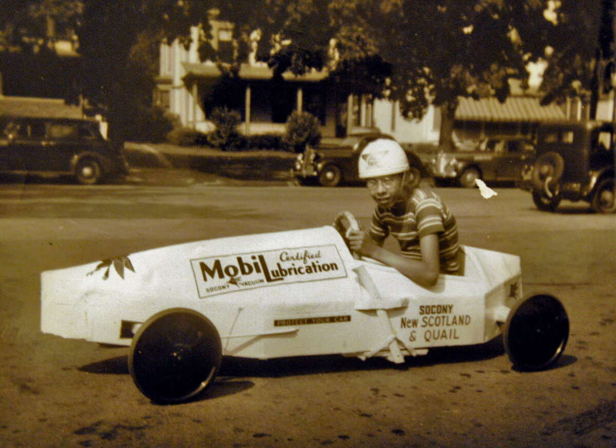 Copy photo of then 15-yr-old Don Matthews in his winning 1941 Soap Box Derby car in Albany, N.Y.