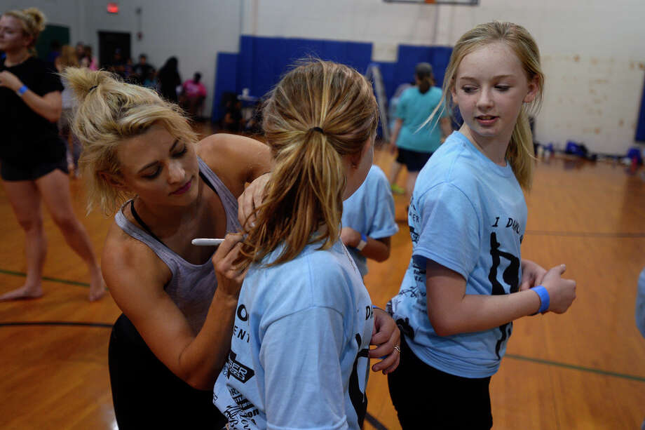 "Lauren Froderman signs autographs after leading a dance class in Orange on Saturday. Froderman won the seventh season of dance competition show ""So You Think You Can Dance.""  Photo taken Saturday 7/30/16 Ryan Pelham/The Enterprise Photo: Ryan Pelham / ©2016 The Beaumont Enterprise/Ryan Pelham"