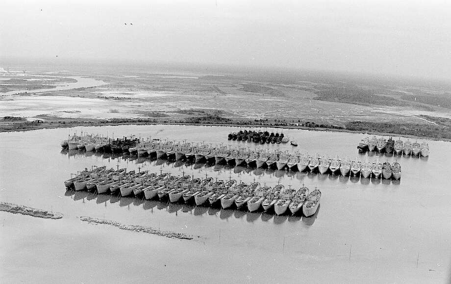 """Beaumont's """"mothball fleet"""" was one of eight national shipyards operated by the U.S. Maritime Reserve along the nation's three major coastlines. The sites acted as a vital part of the nation's defense after WWII, repairing and housing Naval vessels that could be duty-ready as needed in the future.  The fleet provided not only a strategic arm to the nation's defense, but was a local economic boon, as well. Employment both on site and in ancillary industries added work and money to the region.  Enterprise file photo Photo: Kim Brent / Beaumont Enterprise"""