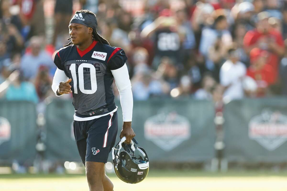 Houston Texans wide receiver DeAndre Hopkins runs onto the practice field following a one-day holdout at Texans Training Camp on Monday, Aug. 1, 2016, in Houston. ( Brett Coomer / Houston Chronicle )