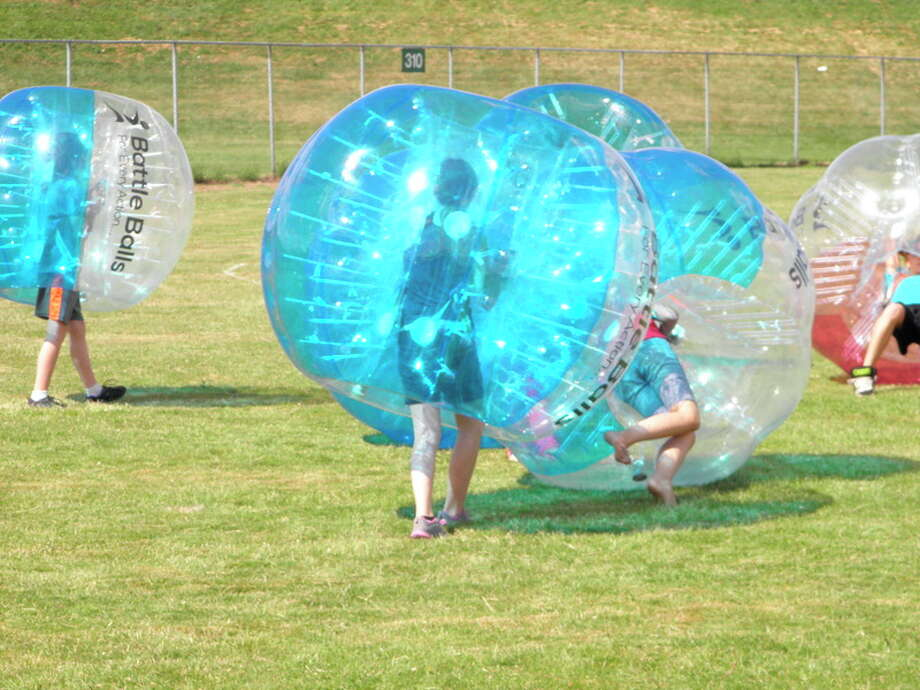 Photo provided Bubble Ball, an activity that originated in Europe about five years ago, is beginning to catch on in the United States. Bay City's John Neetz, hoping to capitalize on the craze, has launched a new business, Tri-City Bubble. The family-run business has been making its presence felt at various special events in the region, including the recent Bay City Fireworks Festival (below). Neetz's company also has been added to the lineup of activities for the 3rd annual Slip Slidin' for Charity event, scheduled for Aug. 20-21 at Veterans Memorial Park in Bay City.