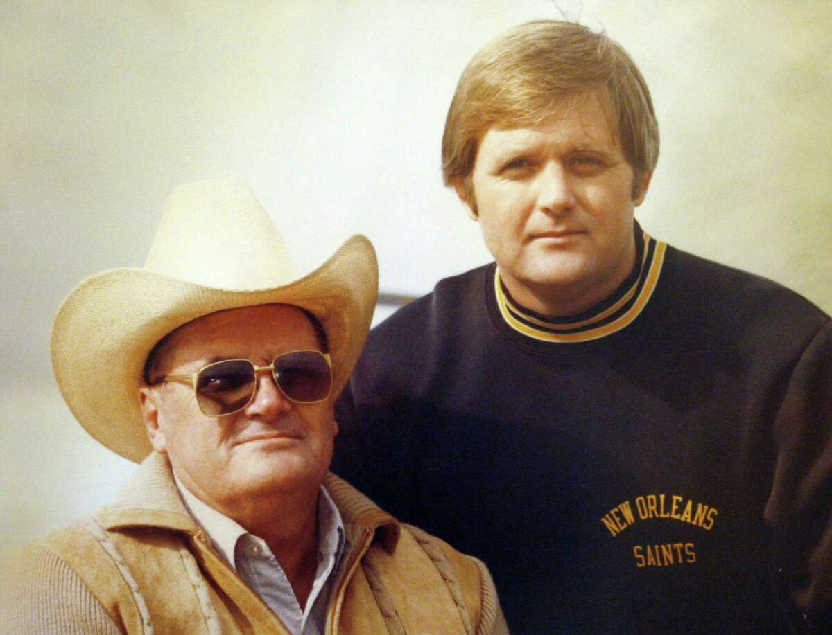 Bum Phillips and son Wade Phillips in a copy photo of a family portrait photographed at their home in Dallas on Friday, December 14, 2007. 01132008xNEWS