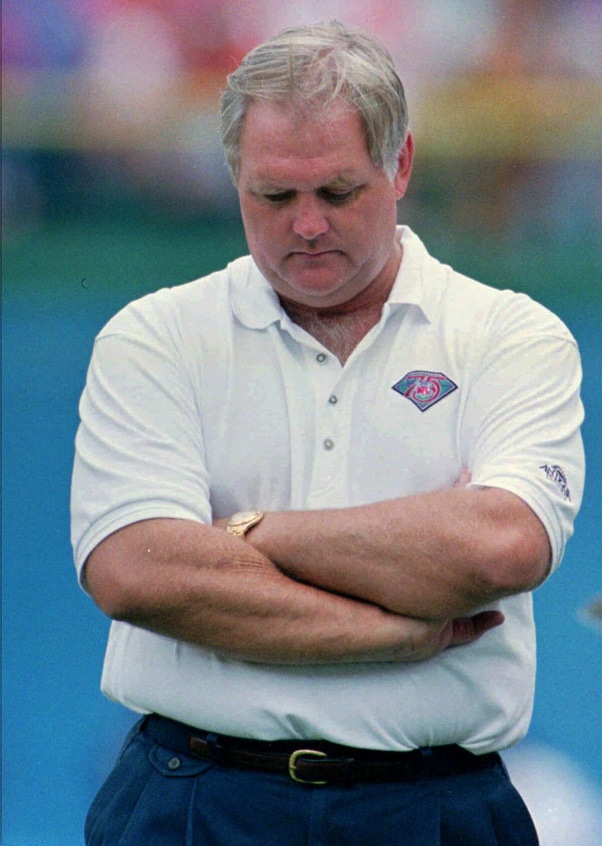 FILE--Head bowed and arms akimbo, Denver Broncos head coach Wade Phillips walks the sideline during his team's 48-16 drubbing at the hands of the Los Angeles Raiders Sunday, Sept. 18, 1994, in Denver's Mile High Stadium. The Broncos fired Phillips on Thursday, Dec. 29, after two seasons as head coach. (AP Photo/David Zalubowski)