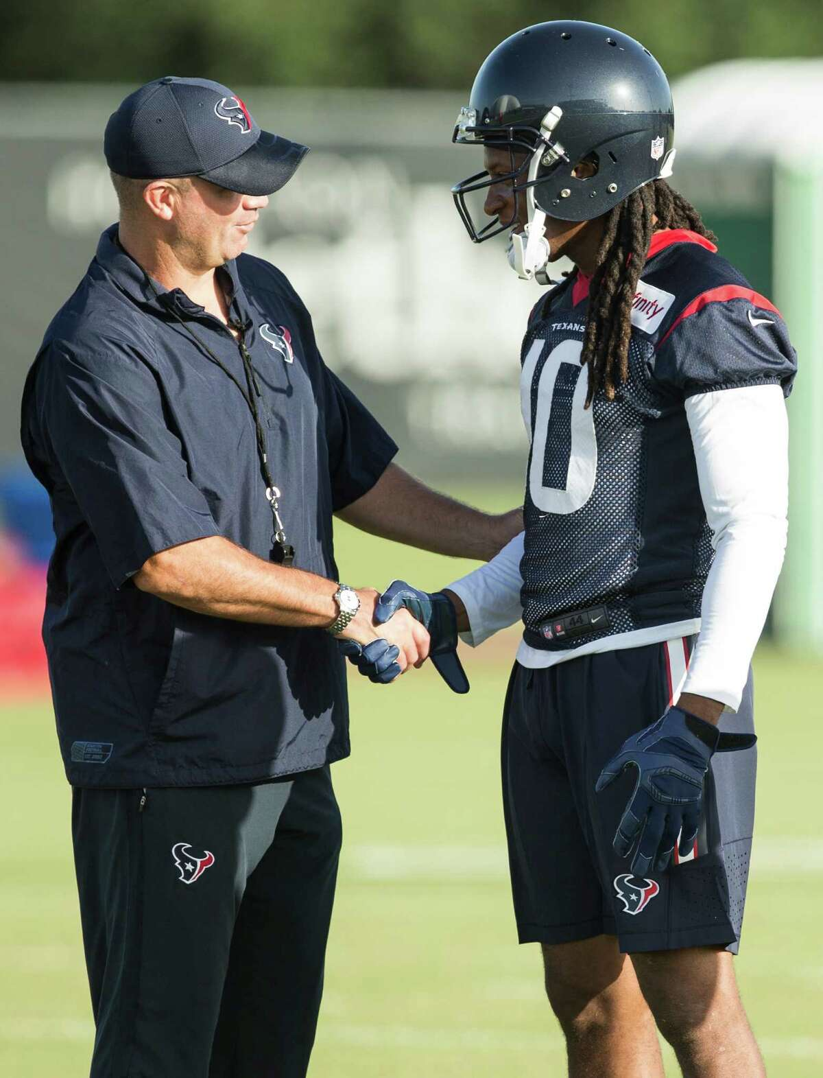 Houston Texans head coach Bill O'Brien welcomes wide receiver DeAndre Hopkins (10) back to pratice, following a one-day holdout, during Texans training camp at Houston Methodist Training Center on Monday, Aug. 1, 2016, in Houston.