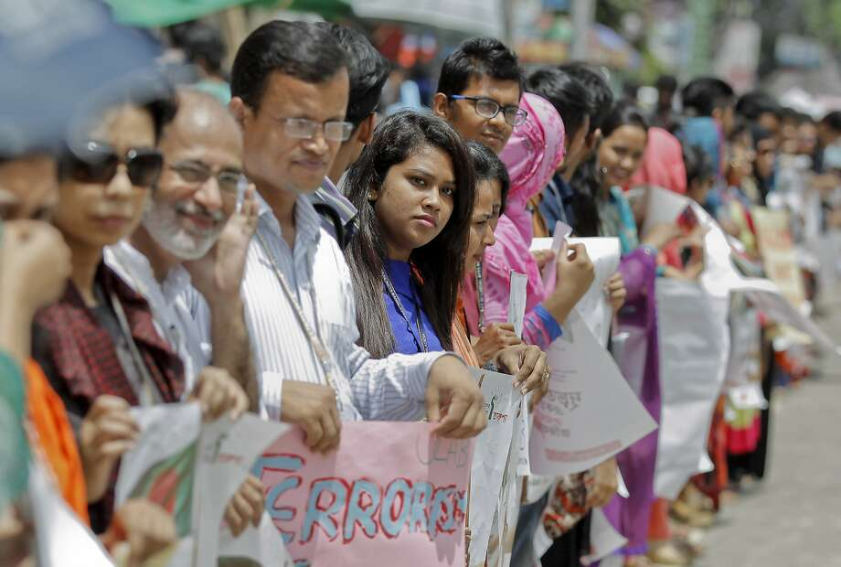 Students and teachers form a human chain to protest against terrorism in Dhaka, Bangladesh. Photo: Associated Press
