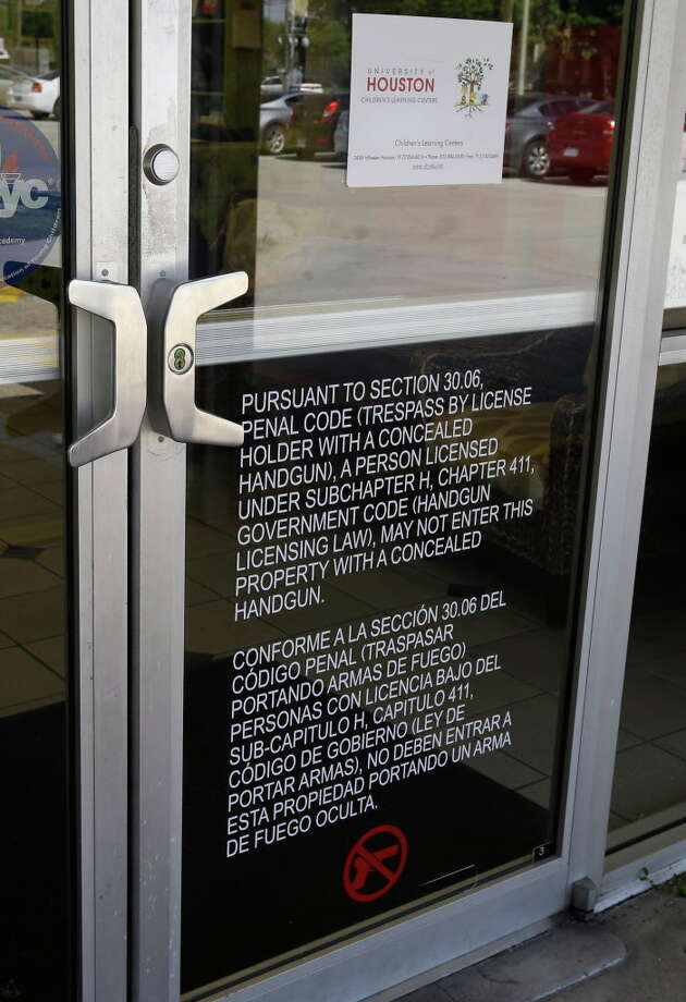 A sign on the door of the University of Houston Child Care Center, 4139 Wheeler St., states that concealed handguns are not permitted shown Monday, Aug. 1, 2016, in Houston. Photo: Melissa Phillip, Houston Chronicle / © 2016 Houston Chronicle