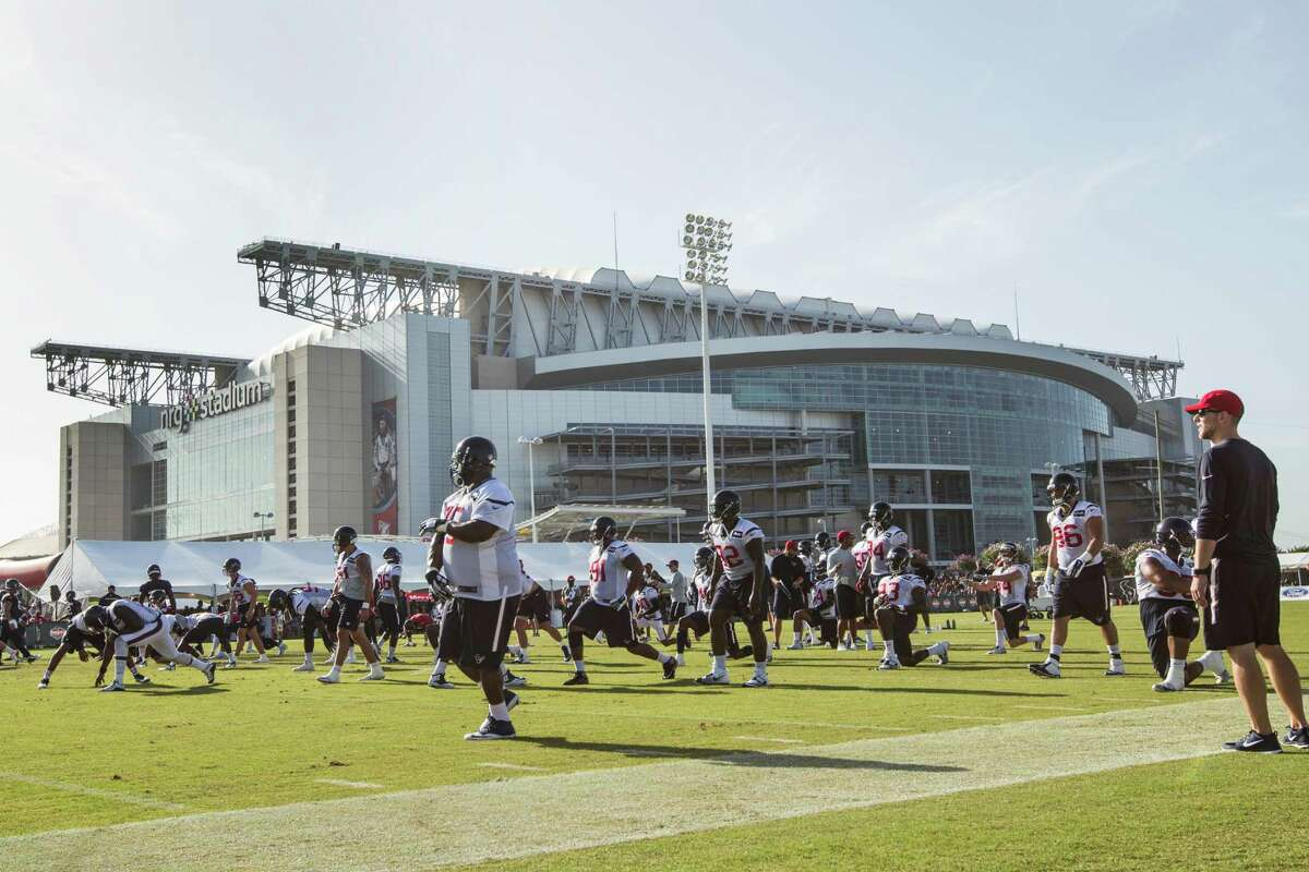 Houston Texans players warm up during Texans training camp at Houston Methodist Training Center on Monday, Aug. 1, 2016, in Houston.